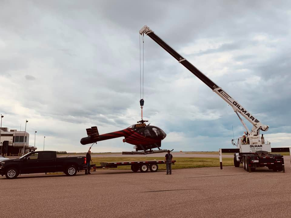 Gilmar Crane lifting a helicopter onto a trailer.