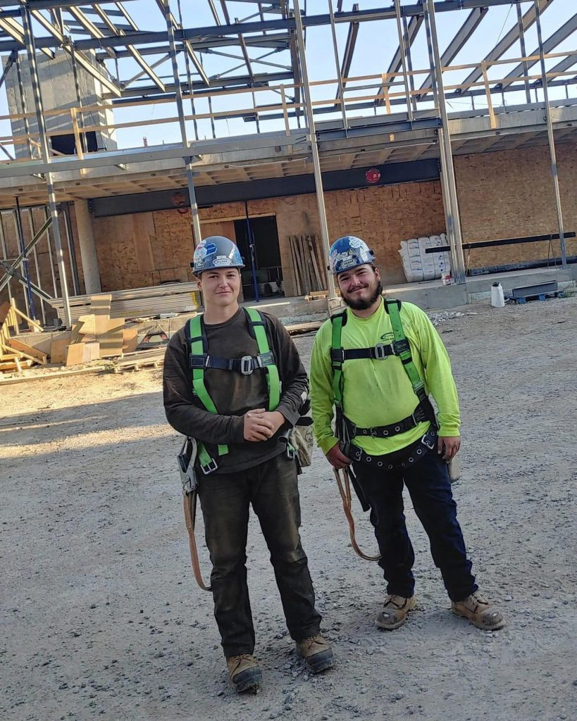 Two brother who work for Gilmar Crane in their work gear